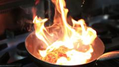 Chef In A Restaurant Kitchen Cooking Flambe Style Stock Footage