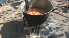 Camping cooking, fire under black pot, vintage cook healthy food, home made food Stock Footage