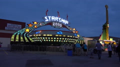 The Gravitron Starship 2000 Fairground Ride Spinning At Night Stock Footage