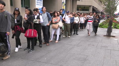 Long lines of people in Toronto for transit buses downtown Stock Footage