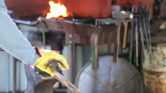 Blacksmith bending hot iron on the anvil. Stock Footage