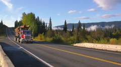 Loaded Log Truck Blasts by on Canada Highway Stock Footage