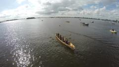 Aerial of rowing crew lady team crewing sailing over the finish line 4k Stock Footage