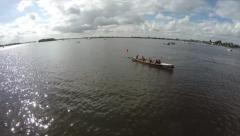 Aerial rowing crew lady team winning the competition over finish line 4k Stock Footage