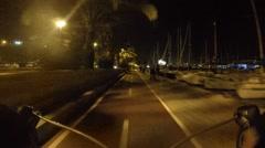 Road bike rider on night bicycle path in Palma, Mallorca - stock footage