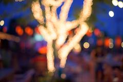 Abstract Bokeh of Gold lights decorated on tree Stock Photos
