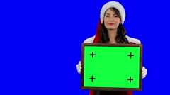 Sexy Santa's helper demonstrates frame for tracking chroma key (green screen) Stock Footage