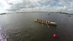 Aerial rowing crew lady team finishing the competition over finish line 4k Stock Footage