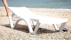 An empty deck chair on the beach Stock Footage