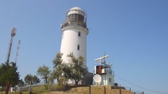 The lighthouse on the hill with the radar station Stock Footage