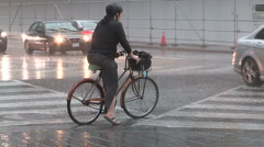 People running for cover in heavy rain wind storm in downtown Toronto. - stock footage