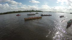 Aerial of finished competition rowing crew team flying over boats together 4k Stock Footage