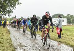 The Cyclist Adam Hansen on a Cobbled Road - Tour de France 2014 - stock photo