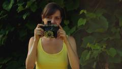 Taking pictures with vintage camera Stock Footage