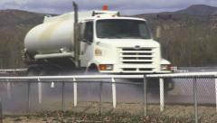 Water Truck Spraying Race Track in Boise close with Audio Arkistovideo
