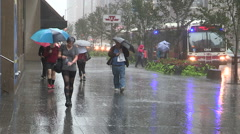 People running for cover in heavy rain wind storm in downtown Toronto. Stock Footage