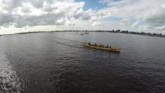 Aerial of side of crew rowing boat team of athletes racing for first place 4k Stock Footage