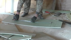 The worker measures a plaster leaf - stock footage