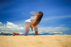girl in lace in yoga asana revolved side angle with hand lock - stock photo
