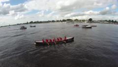 Aerial of the back of a crew rowing boat with a team of athletes racing 4k Arkistovideo