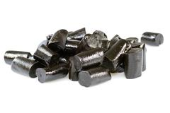 Liquorice candies on white - stock photo