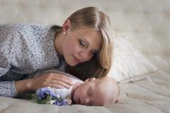 Stock Photo of Young mother and her baby