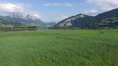 """Aerial Video of lake """"Lauerz"""" in Central Switzerland, low flying, 4K, UHD Stock Footage"""