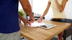 Businessman and businesswoman arguing about some documents. Close-up - stock footage