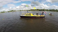Aerial footage of a small dutch motor boat diesel black and yellow 4k Stock Footage