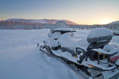 Snowmobile parked, Finland Stock Photos