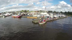 Aerial of people sitting on a wooden pier of a harbor marina 4k Stock Footage