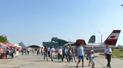 4K 3840x2160. Air show in  museum of aircraft. Planes, helicopters, peopl Stock Footage