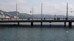 Anonymous Pedestrians crossing the Seebrücke in Lucerne Stock Footage