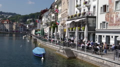 Restaurants on Reuss river in Lucerne Stock Footage