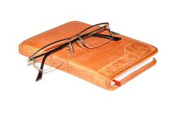 Glasses on the notebook Stock Photos