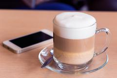 coffee latte with milk froth in cafe - stock photo