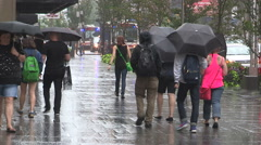 Stock Video Footage of People running for cover in heavy rain wind storm in downtown Toronto.