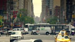 Manhattan busy street traffic intersection New York City NYC cars day Stock Footage