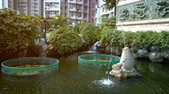 Beautiful Fountains in a Buddhist Temple Garden Pond Stock Footage