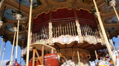 A carousel in Paris, France, near the Eiffel tower. Stock Footage