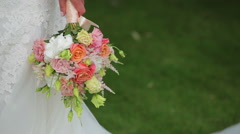 bride holding a wedding bouquet 2 - stock footage