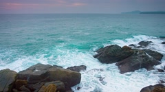 Gentle Waves of a Tropical Sea washing over Boulders - stock footage