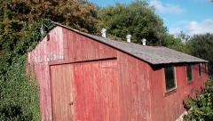 Old Shed Barn Neglected with Interesting Ivy on Left Side, Aerial with Jib Crane Stock Footage