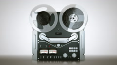 Reel tape-recorder while playing a reel tape on it Stock Footage