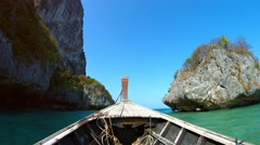 Boat Cruising beneath Limestone Cliffs on a Tropical Sea Stock Footage