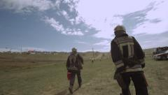 Firefighters run to the scene Stock Footage