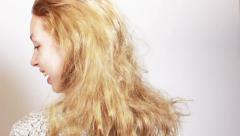 Young girl with long blond hair Stock Footage