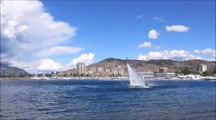 Flyboarding with huge white clouds over the lake Stock Footage