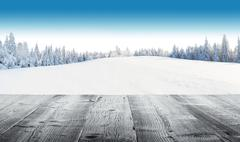 Winter snowy landscape with wooden planks Stock Photos