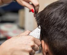 Man having a haircut with a hair clippers - stock photo